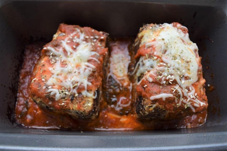 Tofu Parm with cheese in baking pan