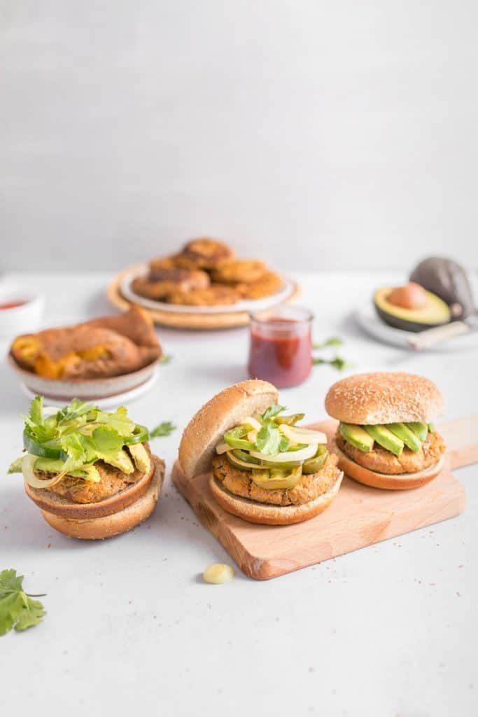 Turkey and sweet potato burgers topped with avocado and on a bun from Bucket List Tummy