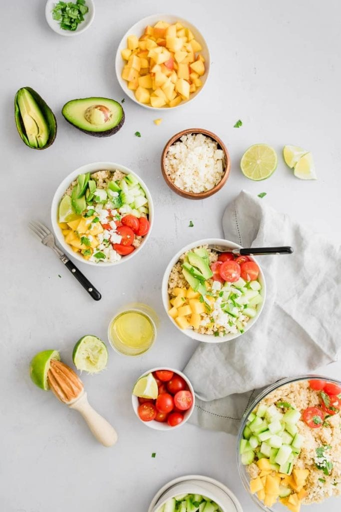 Mango Lime Quinoa Salad is gluten free and a fun spin on pasta salad. Full of light and refreshing veggies, it's a great summer quinoa salad option | Cold Quinoa Salad | Summer Quinoa Salad