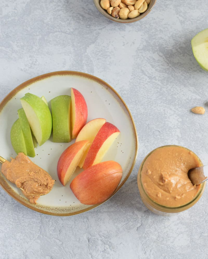 vanilla peanut butter in jar with side of apples on plate