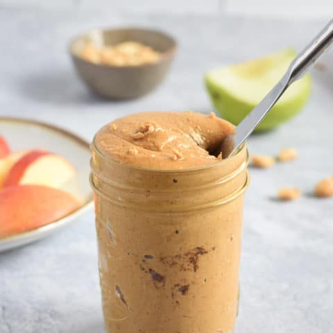 Salted cinnamon peanut butter in glass jar with knife | Bucket List Tummy