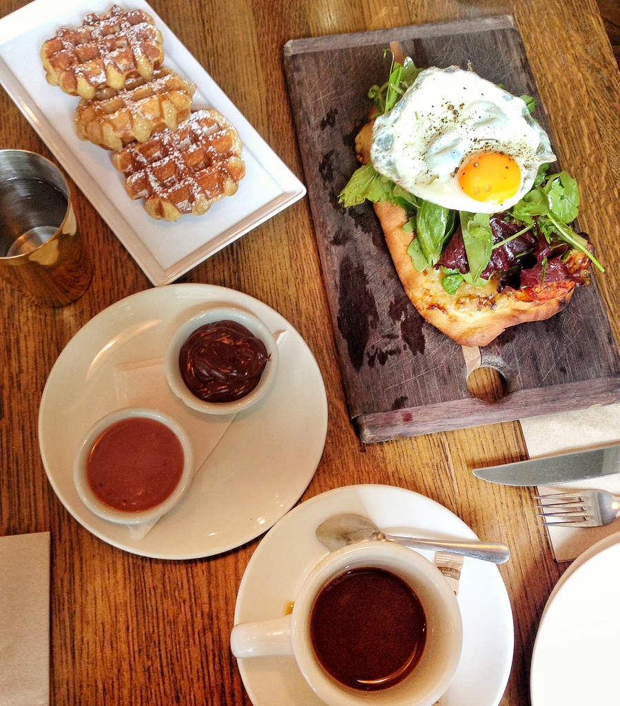 Liege waffles and flatbread with an egg for breakfast at Cafe Medina in Vancouver