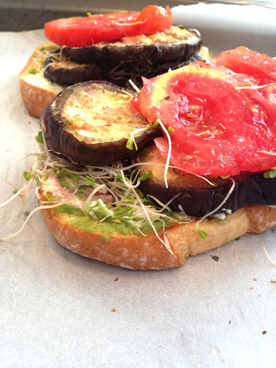 Open faced sandwich with eggplant, tomatoes and sprouts