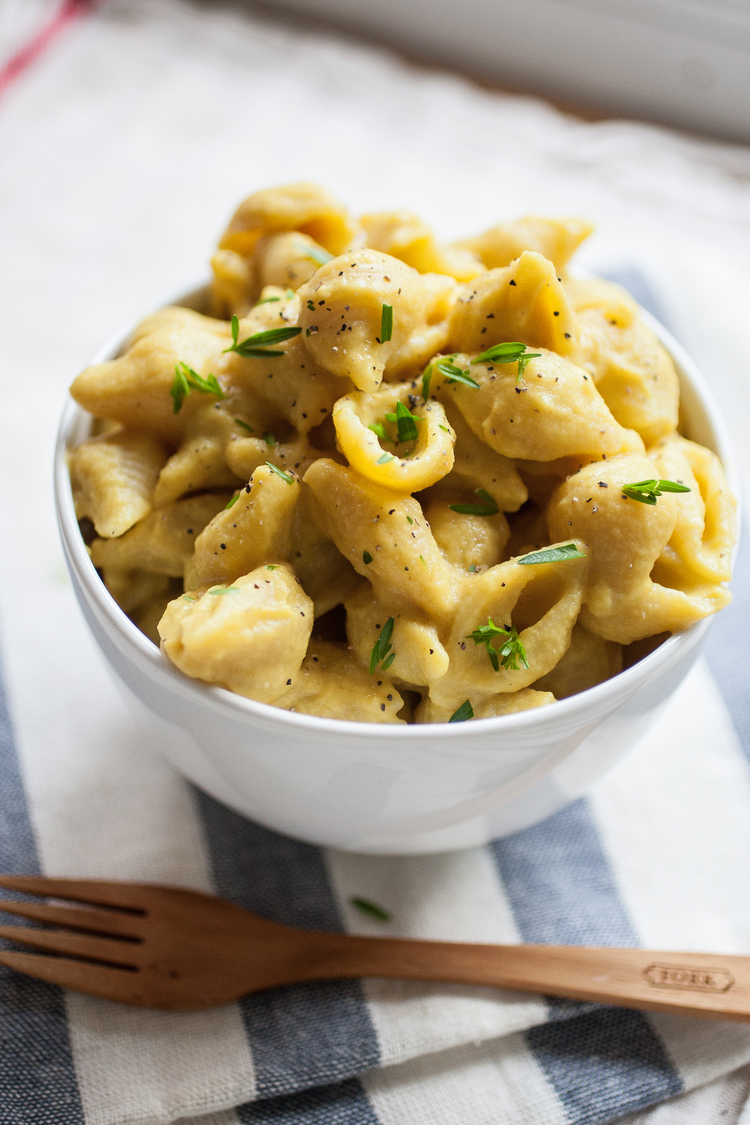 mac n cheese in white bowl made with nutritional yeast