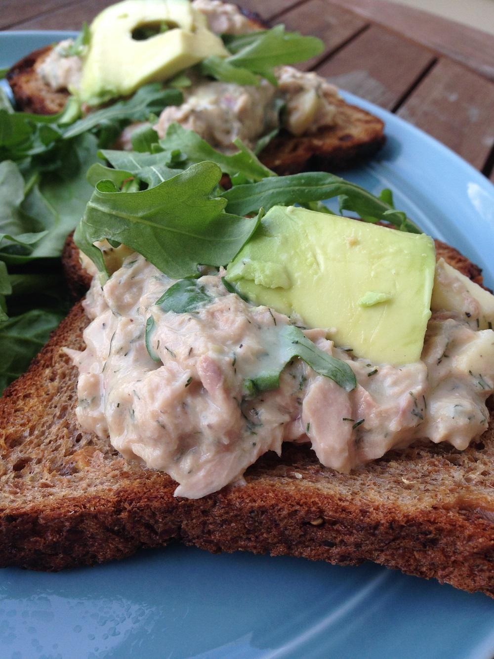 tuna on wheat toast on blue plate