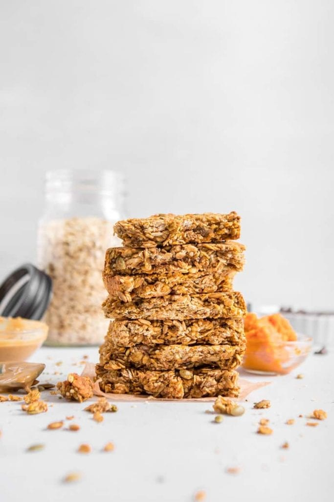 Stacked Vegan Hemp Protein Barsth oats in background