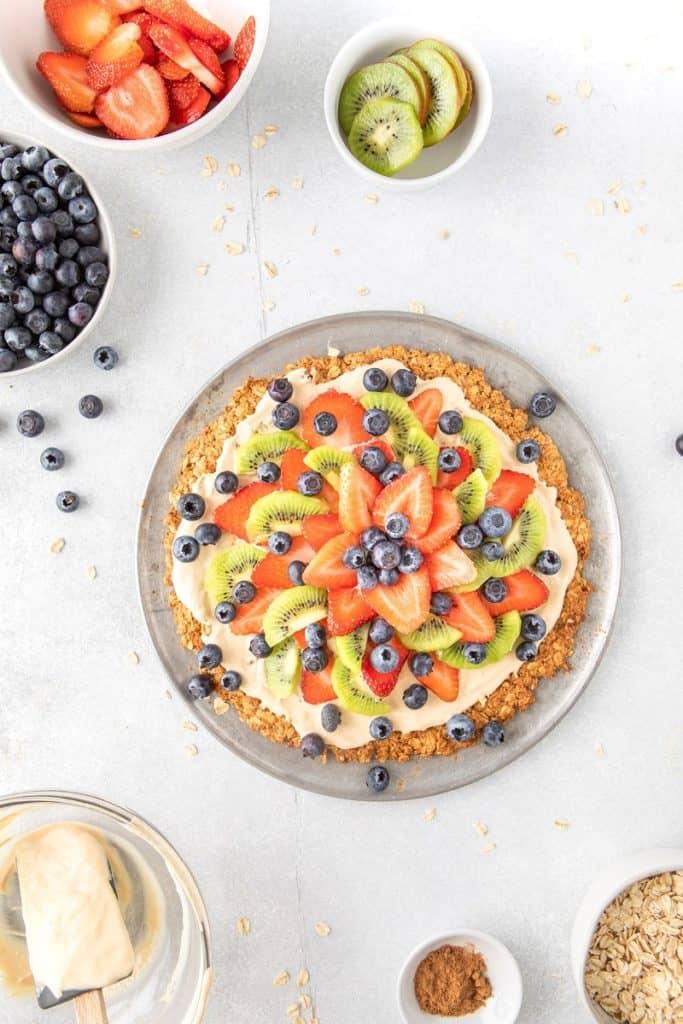 overhead of healthy Fruit pizza recipe topped with fresh berries and greek yogurt yogurt | Bucket List Tummy