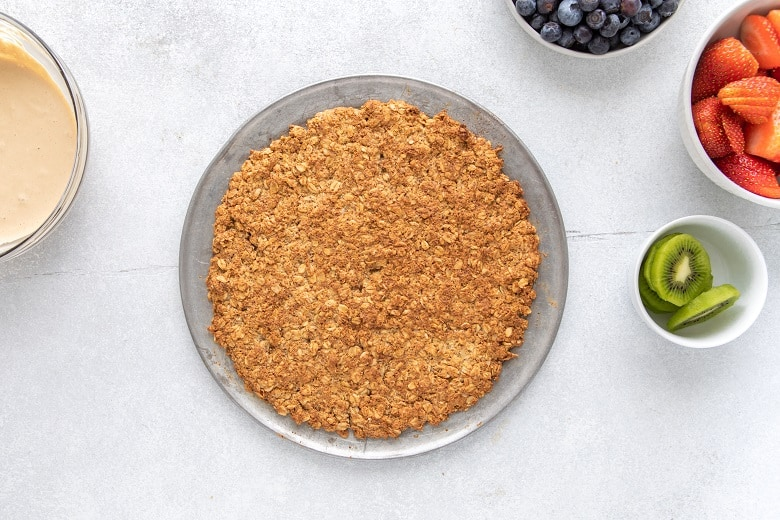 the best fruit pizza for kids, overhead view of almond flour crust | Bucket List Tummy
