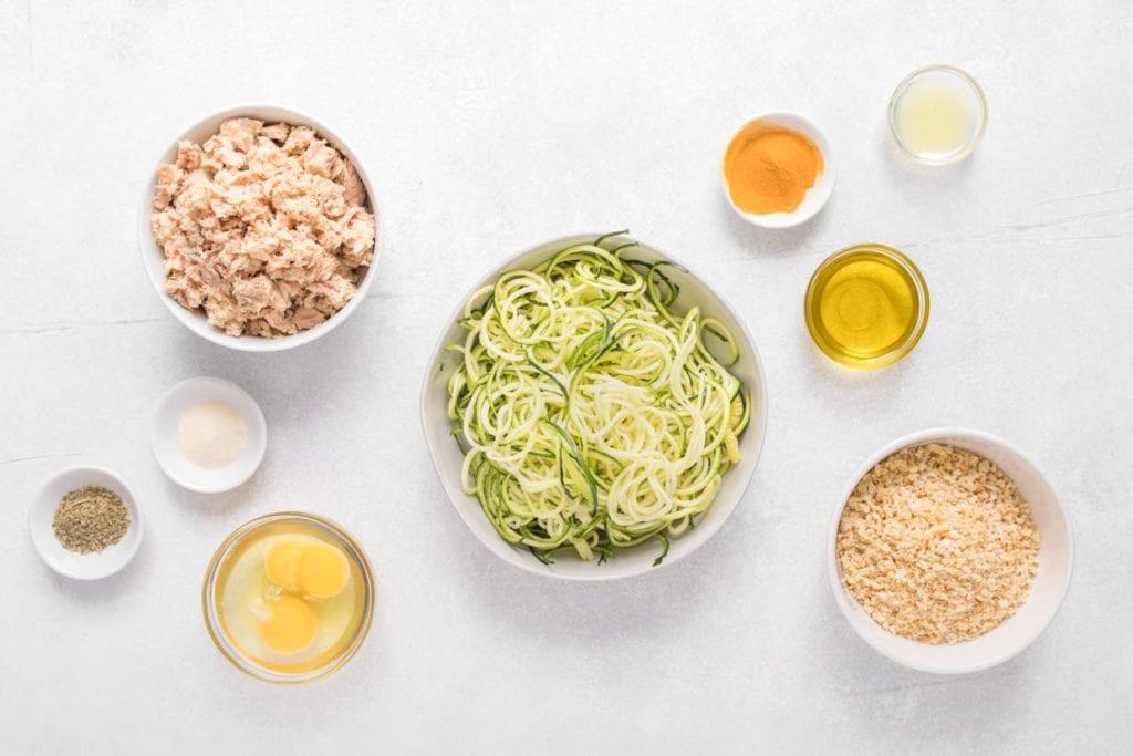 white bowls with ingredients to make salmon patties