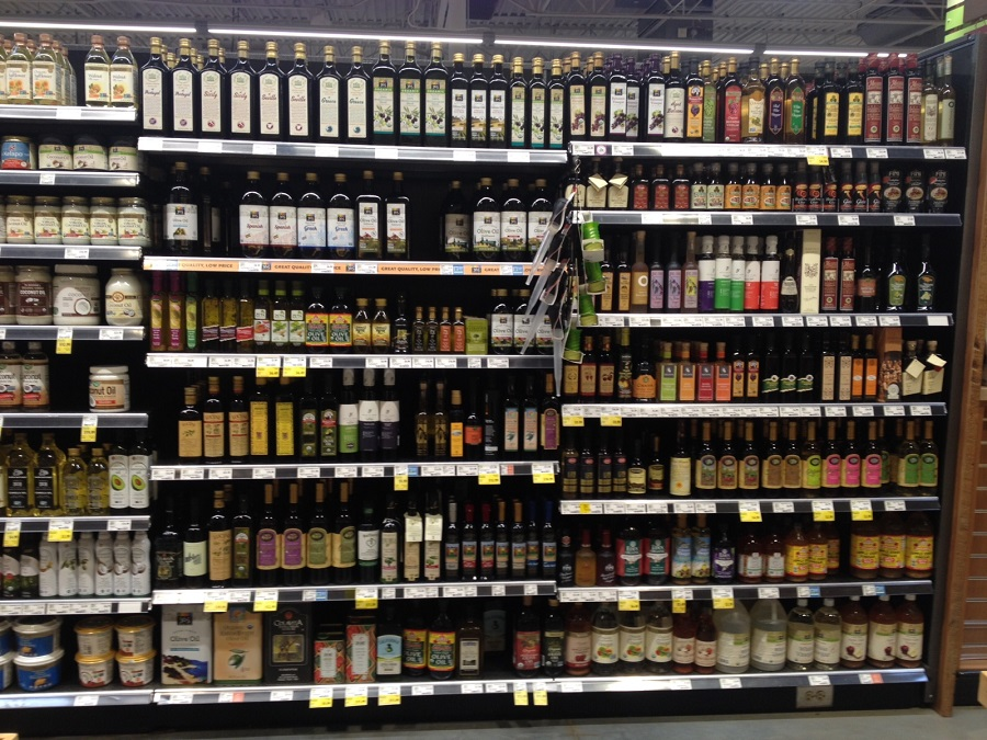 Olive oil and dressings in aisle in Whole Foods