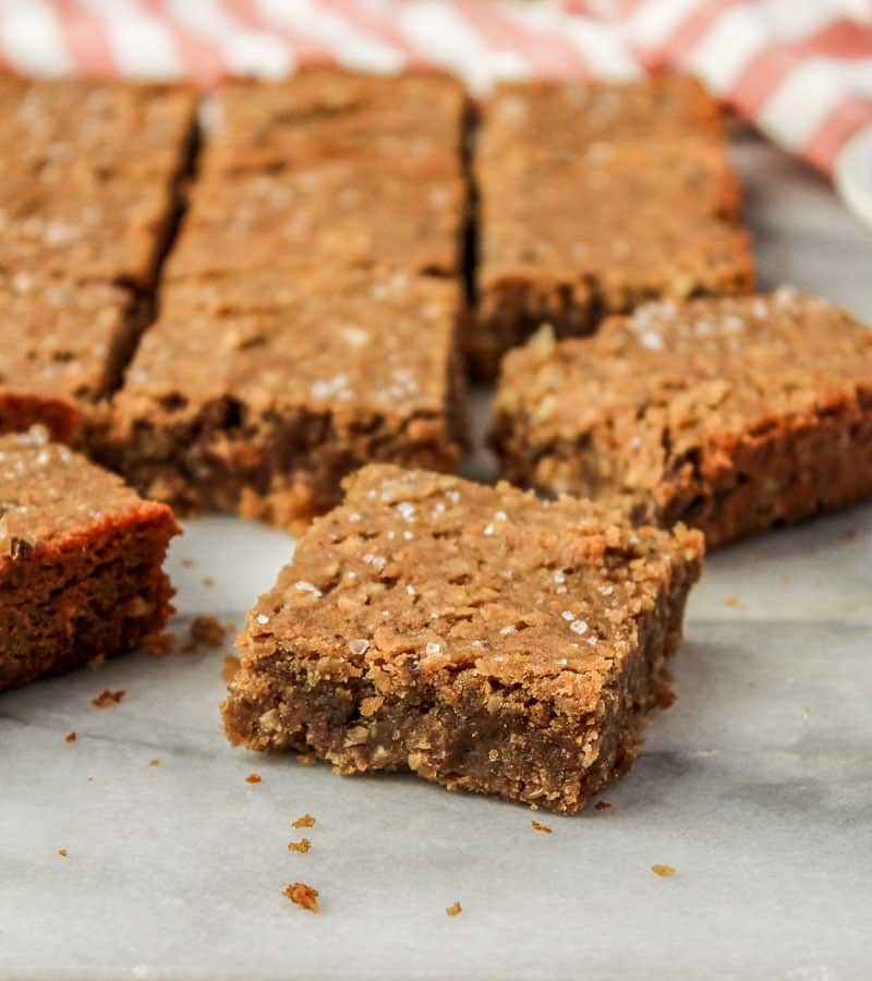 nut free protein bars sprinked with sea salt cut into squares with red striped napkin in background