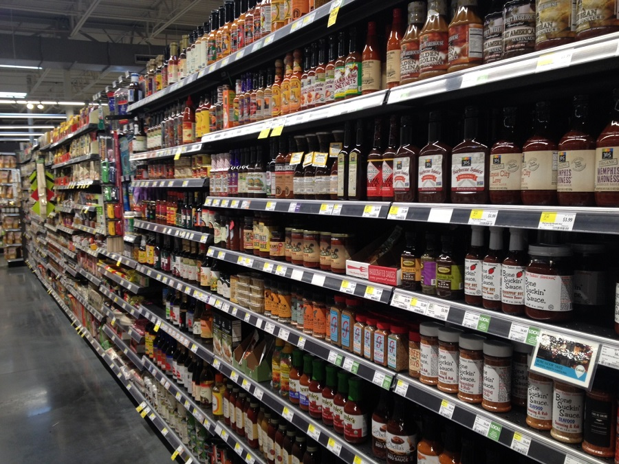 Canned goods in aisle in Whole Foods