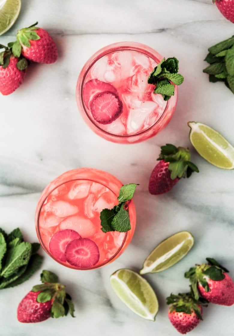 strawberry vodka drinks overhead shot with garnish of mint | Bucket List Tummy