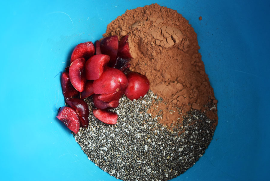 Ingredients to make chocolate vegan chia pudding in blue mixing bowl | Bucket List Tummy