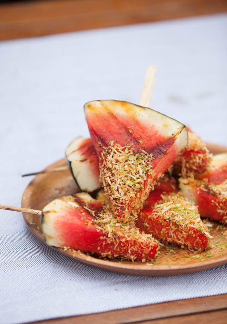 grilled watermelon on skewers on wooden plate