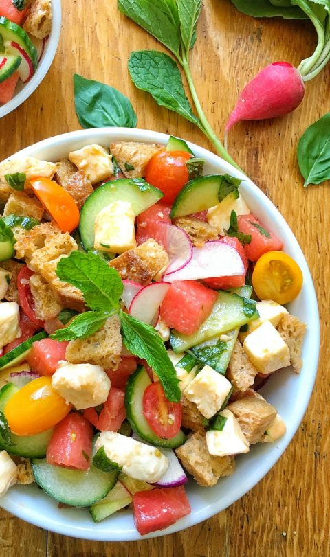 watermelon panzanella salad with croutons and tomatoes in white serving bowl
