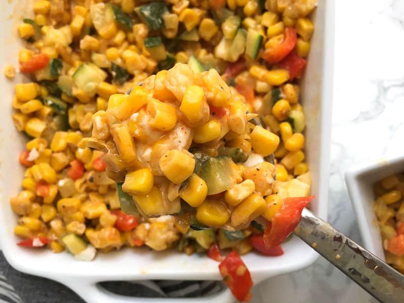 closeup of cheesy mexican street corn dip on spoon | Bucket List Tummy