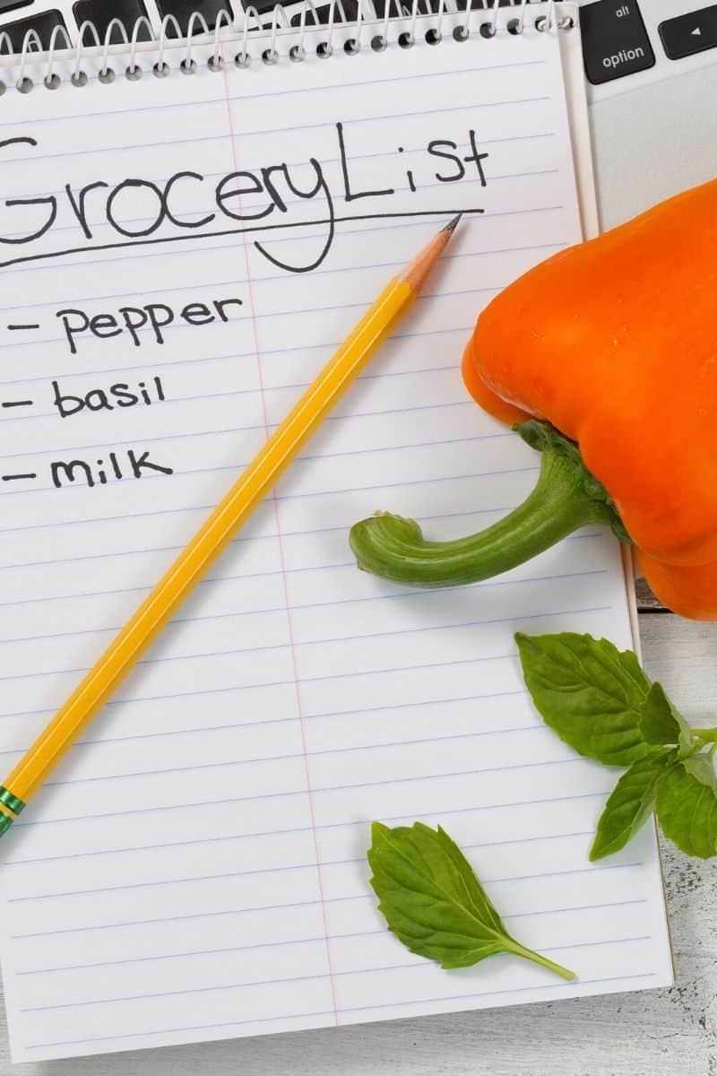 written grocery list with orange pepper