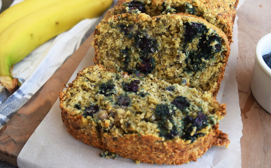 Blueberry Banana Chia Bread makes a great base for a sweet breakfast or on-the-go snack. Made with fruit, chia seeds, oat flour and half the sugar, it's a wholesome, healthy option for the whole family | Low sugar recipe
