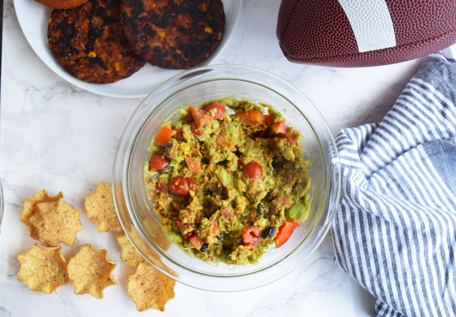This Black Bean Avocado Dip requires only four key ingredients and provides a perfect healthy, vegetarian dip option for your fall tailgates. With a fun twist on guacamole, this Black Bean Avocado Dip is sure to be a hit!