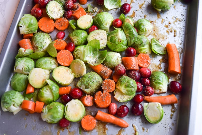 Diced brussel sprouts, carrots and cranberries to roast