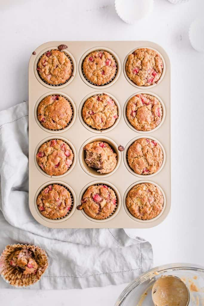 overhead shot of strawberry banana chickpea flour muffins in muffin tin | Bucket List Tummy