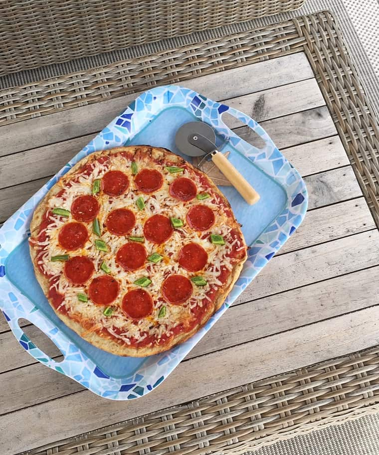homemade pepperoni pizza on blue serving platter