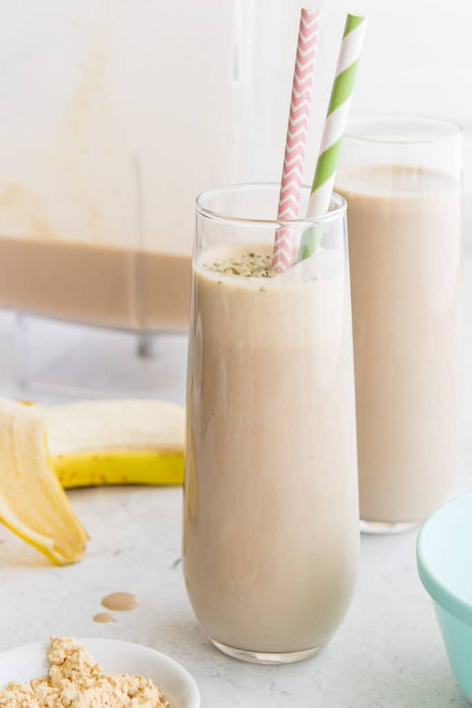 peanut butter coffee smoothie in clear glass with straws