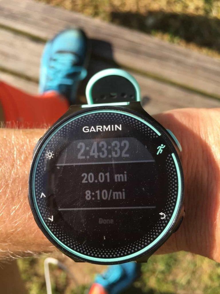 Garmin running watch on wrist showing 20 miles