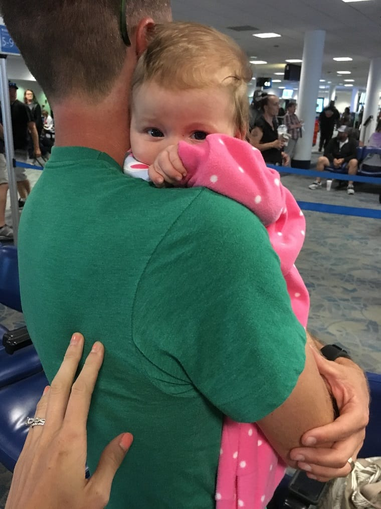 Picture of dad holding infant in airport