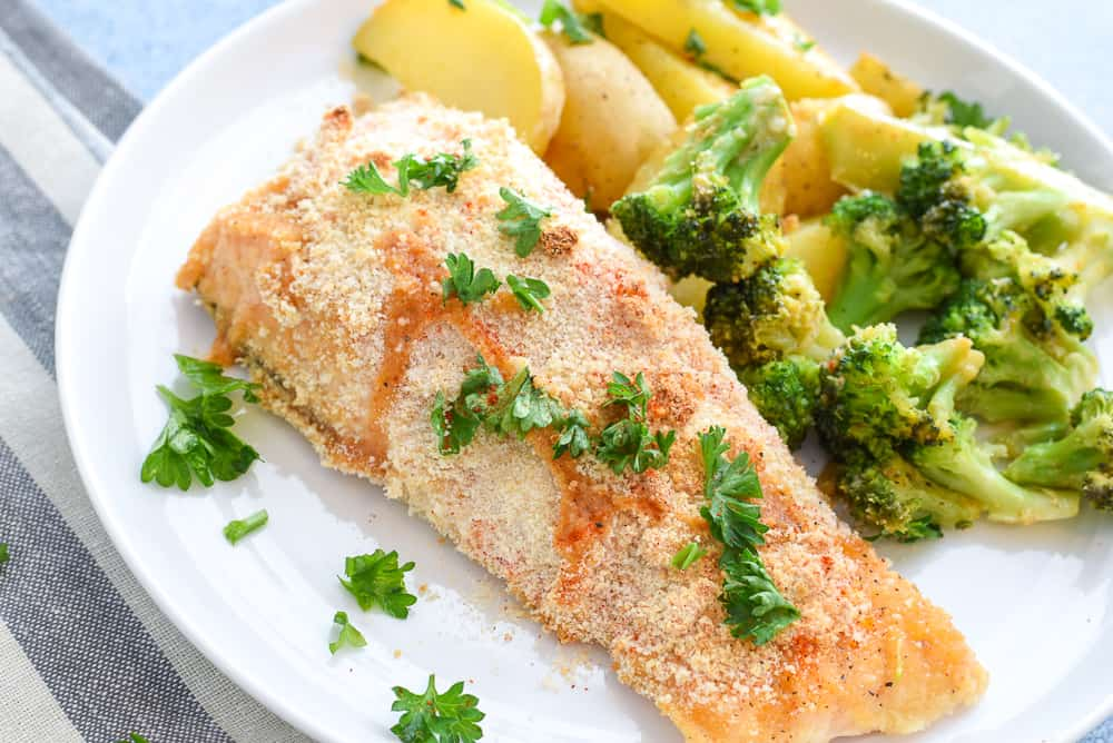 Salmon with vegetables on plate