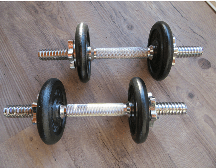 dumbbell weights on wooden floor