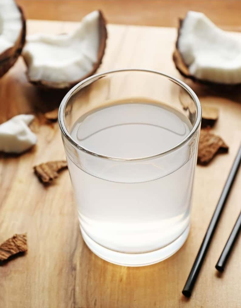 coconut water in clear glass