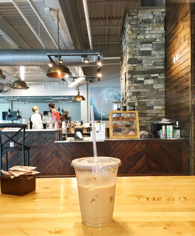 iced coffee on counter in coffee shop. Coffee before running can help improve performance