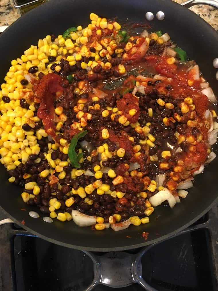 corn and beans in skillet on stove