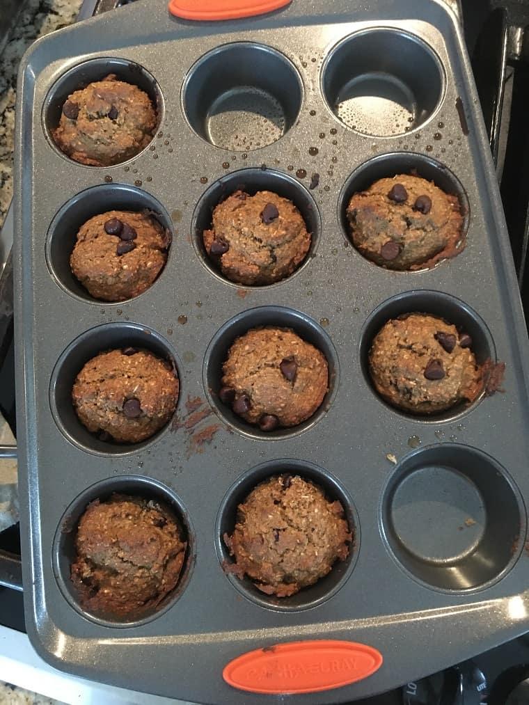 banana chocolate chip muffins in muffin pan