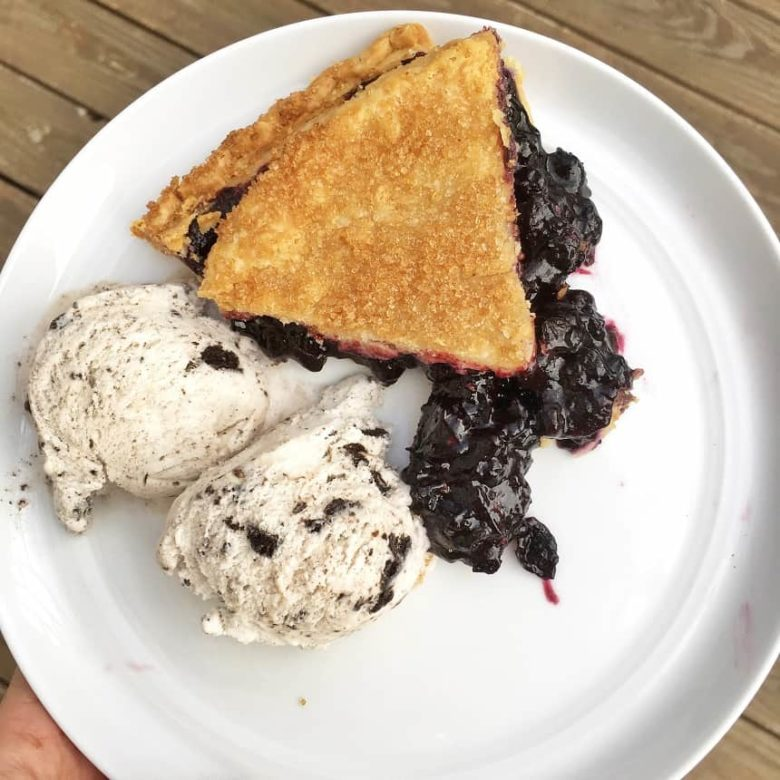 Blueberry pie with ice cream on white plate | Bucket List Tummy