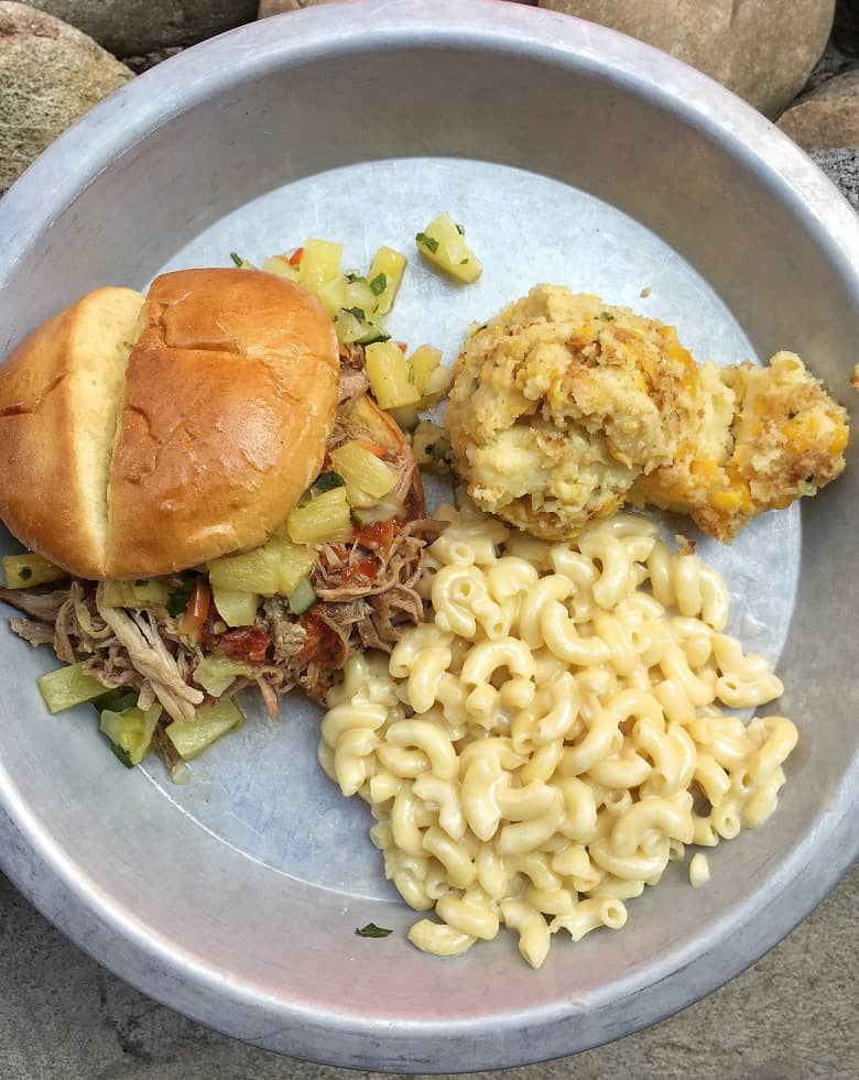 Asheville BBQ sandwich with mac and cheese and biscuit on plate from 12 Bones BBQ