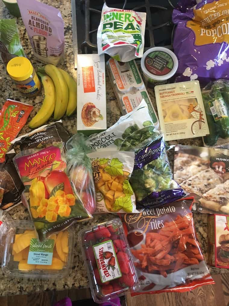 Frozen produce and examples of groceries on a kitchen countertop from recent grocery shopping at Trader Joe's
