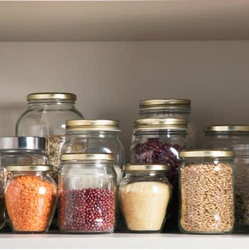 Pantry Staples in glass jars (oats, lentils, beans)