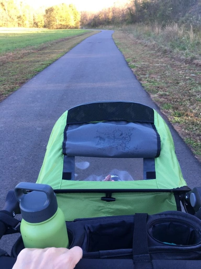 mom running with green BOB stroller on greenway