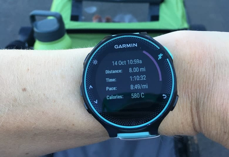 Garmin watch showing 8 mile run while running with stroller