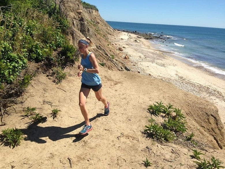 girl running on sandy beach on Block Island