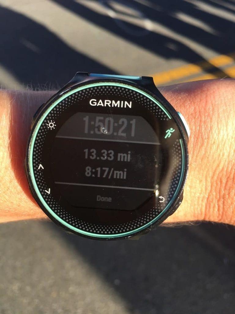 Garmin GPS watch showing 13.33 miles after running a half marathon