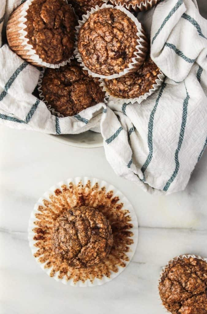 overhead view of almond flour banana muffins on white countertop