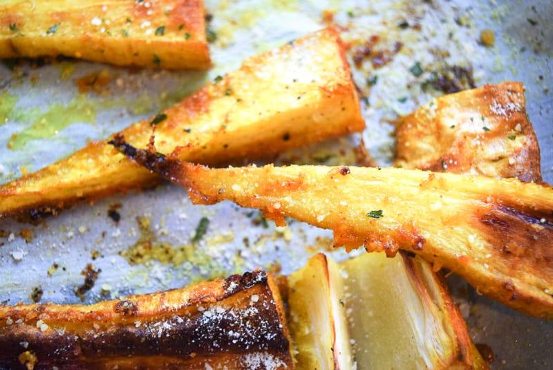 Close up of crispy roast parsnip fries on baking dish | Bucket List Tummy