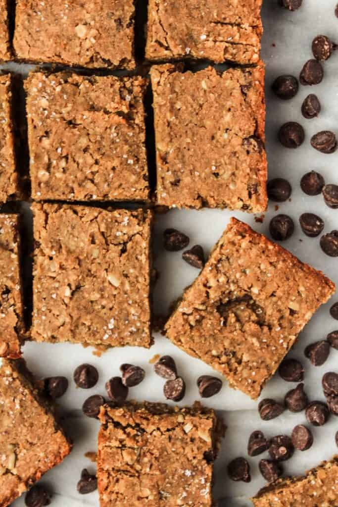 Overhead view of vegan protein bars with chocolate chips on gray countertop