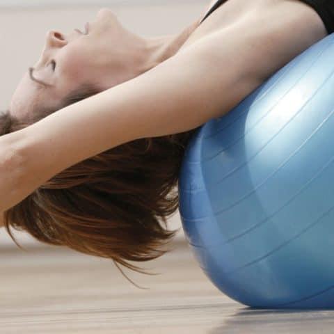 woman on a yoga strength ball