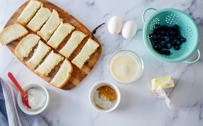 Baby French Toast ingredients: bread, eggs, milk, blueberries, butter