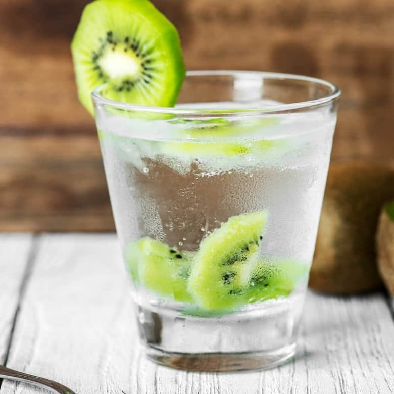 glass of water with kiwi for hydration before exercise